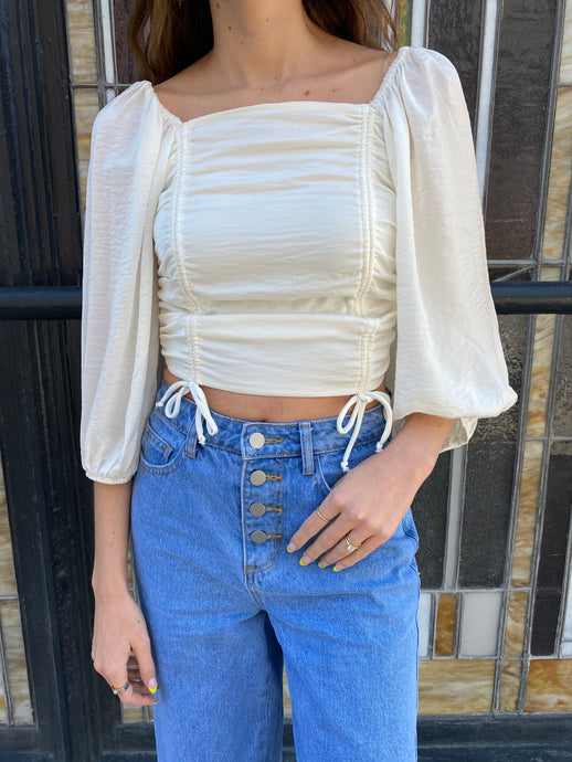 White top with puffy sleeves