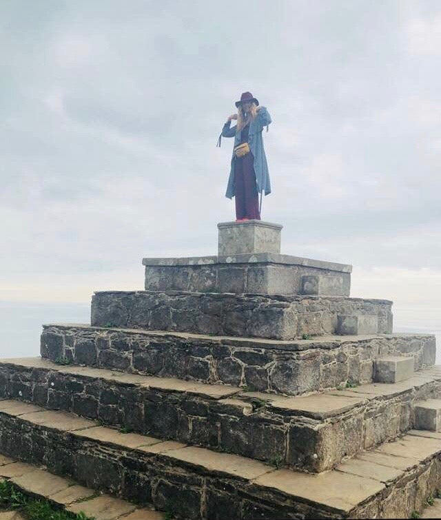 P Susan Jackson at the top of a pyramid in Ireland.