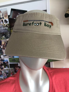 Tan visor with Golf balls and club Barefoot Bay
