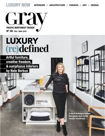 Gray Magazine Luxury Issue featuring Stock & Pantry cover story. Color image shows store interior with displays and owner Sasha Clark leaning on central display table.