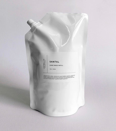 Large white refill bag of scented hand wash, santal