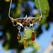 Amber and Sterling Artisan Pendant with Teardrop Dangles