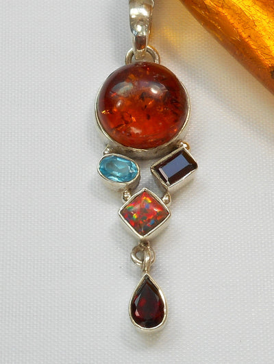 Amber Pendant 8 with Topaz, Garnets and Opal