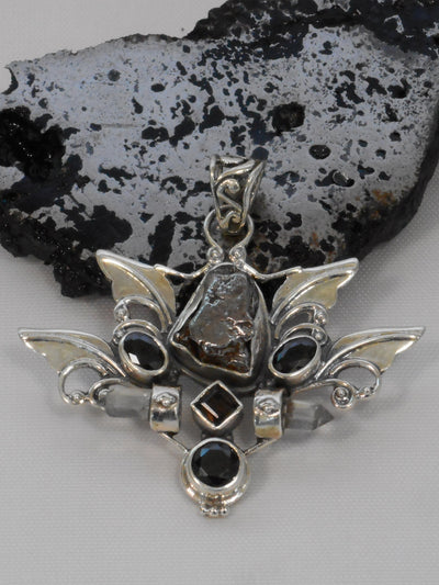Angel Sterling and Meteorite Pendant 1 with Garnets and Quartz Crystals