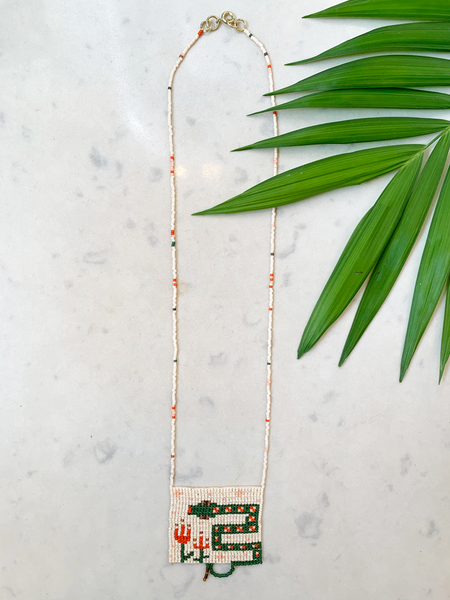 "Hand woven beaded necklace with glass beads and gold-tone hardware. Necklace hangs approximately 12.5"". Gold-tone hardware.  *Made to order - please allow 2 weeks + delivery time."