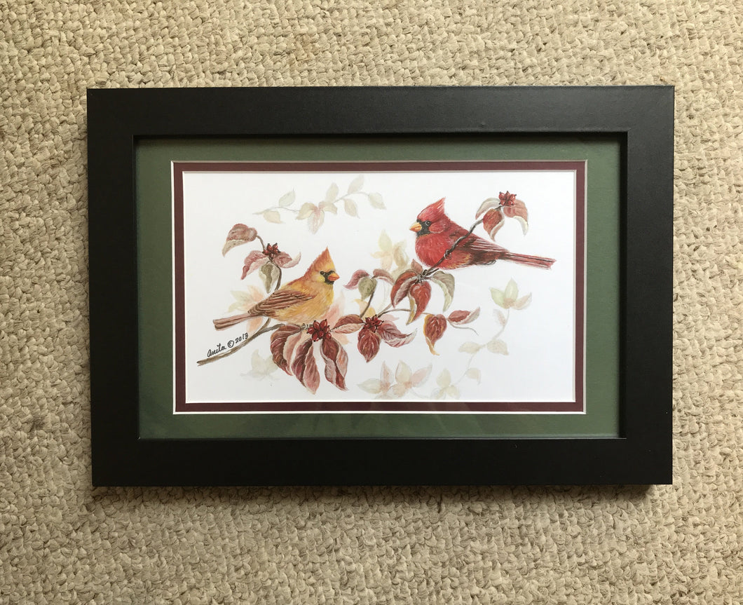 Cardinals matted in green with black frame