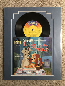 Ready to frame 11x14 vintage record and book. Lady and Tramp