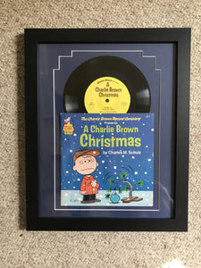 """A Charlie Brown Christmas"" vintage record matted and framed."