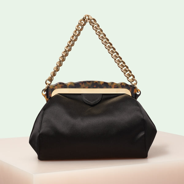 Edie Parker designer handbag Aliza Satin in black featuring tortoise rhodoid frame with magnetic closure, and goldtone top handle chain.