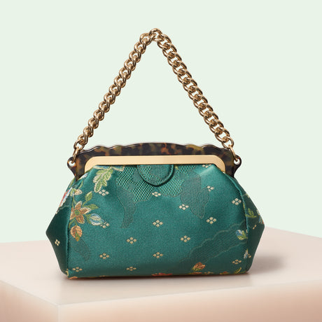 Edie Parker designer handbag Aliza Silk Brocade in green multi featuring tortoise rhodoid frame with magnetic closure, and goldtone top handle chain.