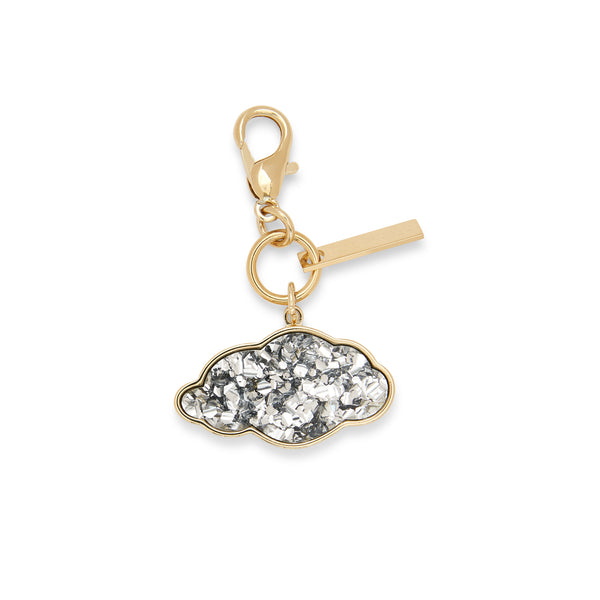 Edie Parker designer Cloud Charm in silver confetti with gold hardware.