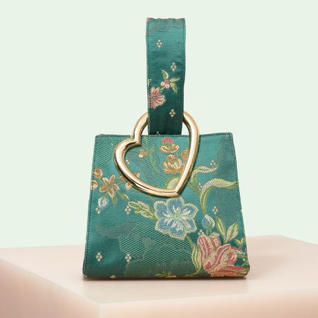 Edie Parker designer handbag Heart Wristlet in green multi floral satin with loop top handle and metal heart.