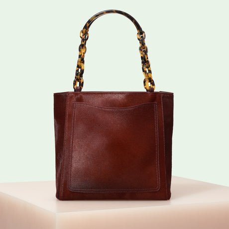 Edie Parker designer handbag Mini Tote in Bordeaux Haircalf with double tortoise rhodoid top handle chain.