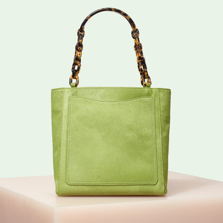 Edie Parker designer handbag Mini Tote in Pea Green Haircalf with double tortoise rhodoid top handle chain.