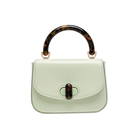 Edie Parker designer handbag Mini Top Handle in mint green flat top with tortoise rhodoid top handle and turnlock closure.