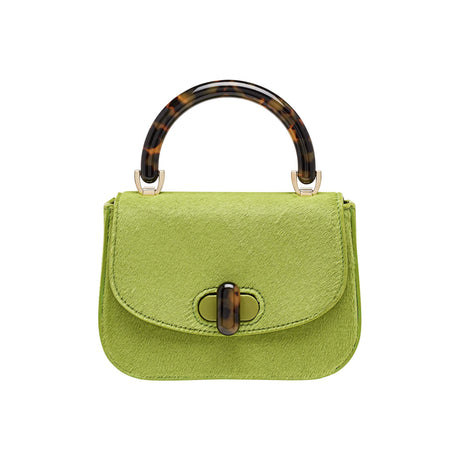 Edie Parker designer handbag Mini Top Handle in pea green haircalf flat top with tortoise rhodoid top handle and turnlock closure.