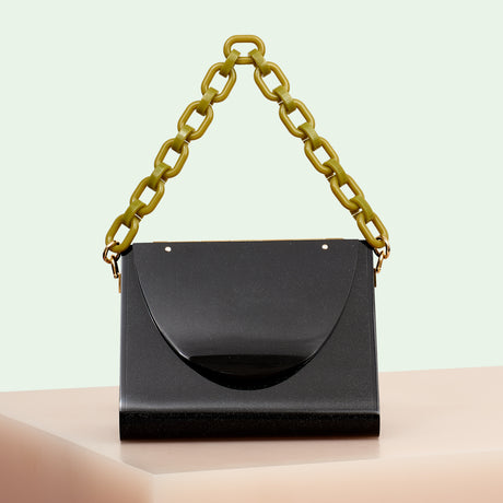 Edie Parker designer handbag Triangle bag in obsidian black flat top with mustard top handle chain.