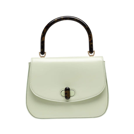Edie Parker designer handbag Large Top Handle in mint green flat top with tortoise rhodoid top handle and turnlock closure.