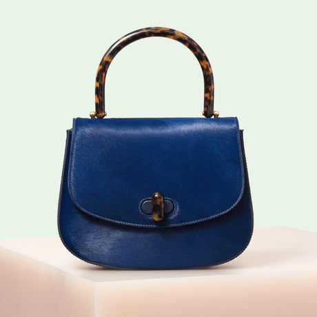 Edie Parker designer handbag Large Top Handle in navy haircalf flat top with tortoise rhodoid top handle and turnlock closure.