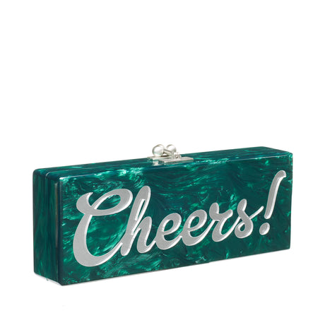 Flavia Cheers! Designer clutch handbag in emerald green pearlescent featuring clear mirror block text and silver hardware.