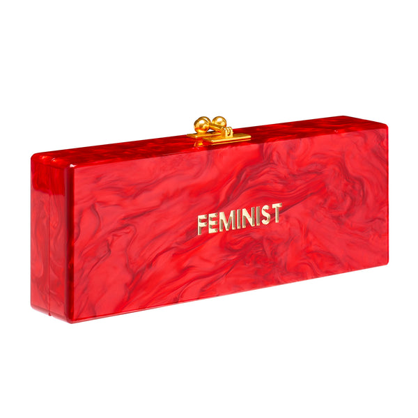 Flavia Feminist in red pearlescent featuring mini script mirror text with silver hardware