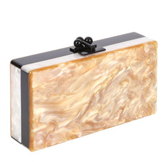 Edie Parker Jean Color Block Caramel Pearlescent Handbag Clutch Black and White Stripe Sides Feature Image