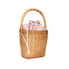 Edie Parker Lily Basket handbag woven straw corduroy floral print drawstring straw handle angled view feature angled view