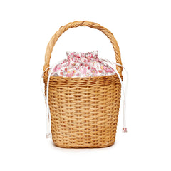 Edie Parker Lily Basket handbag woven straw corduroy floral print drawstring straw handle angled view feature back view
