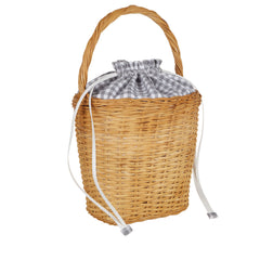 Edie Parker Lily Basket handbag woven straw gingham cotton checked print drawstring straw handle feature angled view
