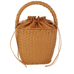 Edie Parker Lily Basket handbag woven straw caramel brown leather drawstring straw twisted handle front view