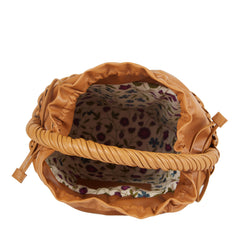 Edie Parker Lily Basket handbag woven straw caramel brown leather drawstring straw twisted handle interior view with signature cotton floral printed lining