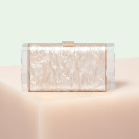 Edie Parker designer Lara Backlit Love and Stars clutch handbag in nude pearlescent with acrylic backlit ice ends featuring stars and LOVE inlay on each ice end.