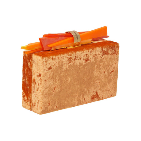 Edie Parker Wolf Velvet designer clutch handbag in orange velvet with shard lock detail with signature cotton lining.