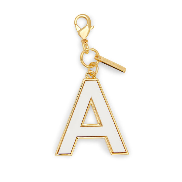 a, Edie Parker designer accessories Initial Charm in White with gold hardware.