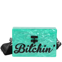 Edie Parker Kelly Green Pearlescent Bitchin' Cursive Text Small Trunk Crossbody Handbag Black Studded Strap Front View