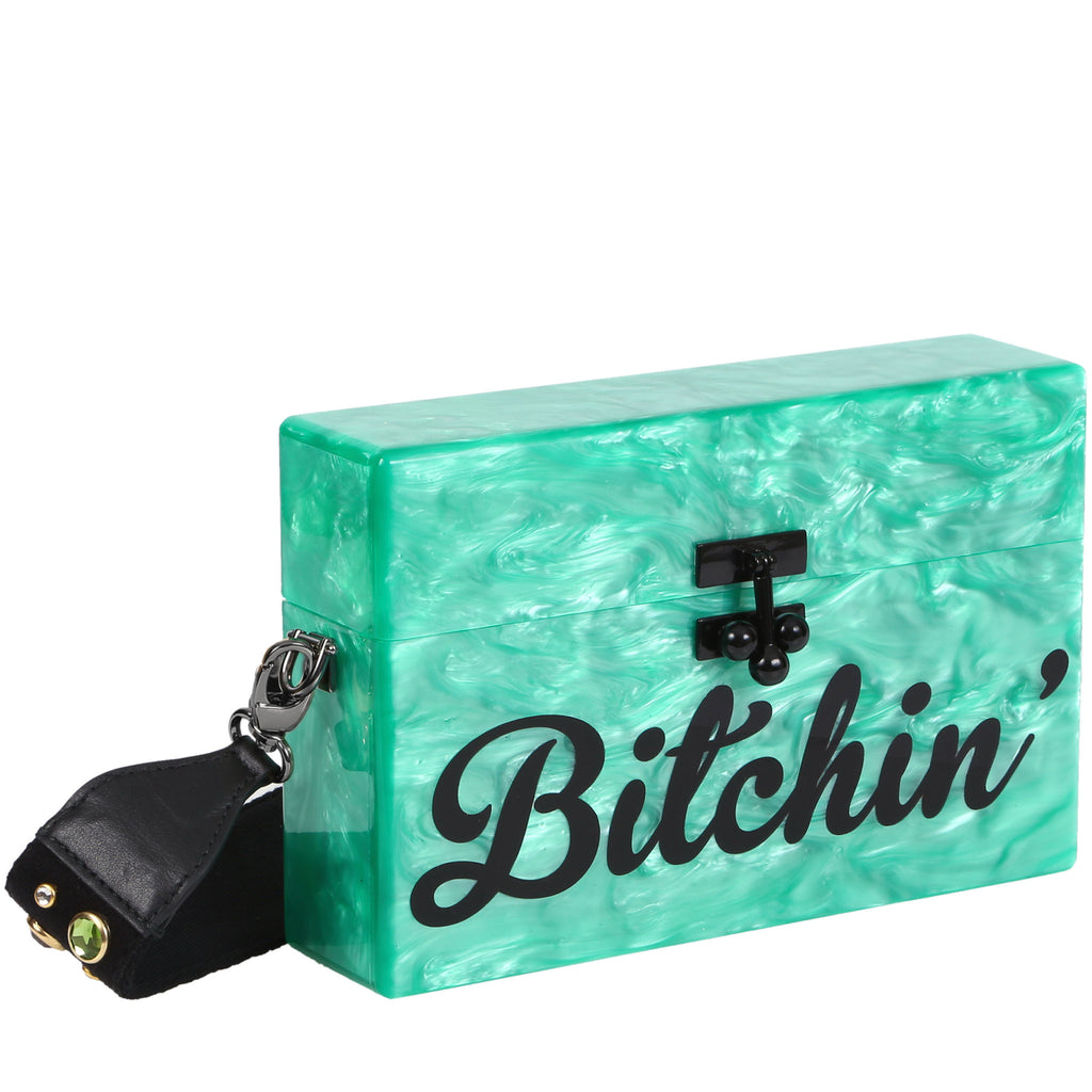Edie Parker Kelly Green Pearlescent Bitchin' Cursive Text Small Trunk Crossbody Handbag Black Studded Strap Feature Image