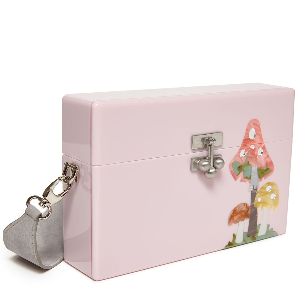 Edie Parker Small Trunk Shroom in Pink with mushroom motif in green yellow multi color with gray suede strap angled view