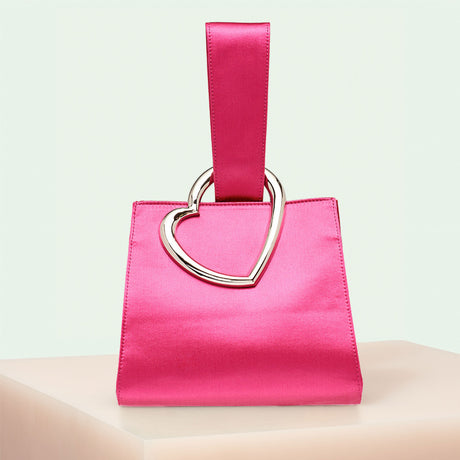 Edie Parker Heart Wristlet designer handbag in Hot Pink Satin with loop top handle and gold metal heart.