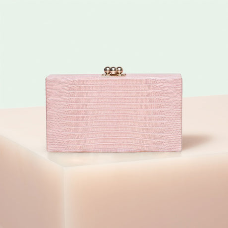 Edie Parker designer handbag clutch Jean Lizard in pale pink painted genuine lizard and kiss lock hardware.