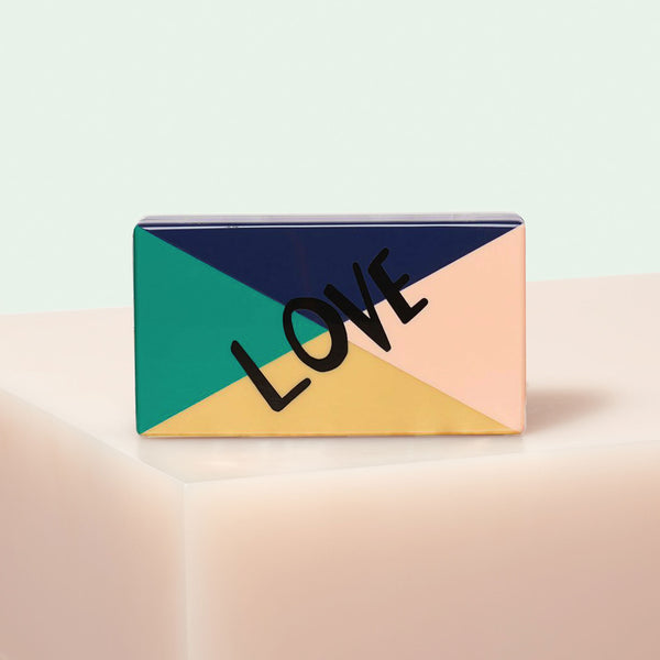 "Edie Parker designer Jean Color Block Love clutch handbag in navy, green, peach and mustard with black ""LOVE"", gold hardware and green chain."