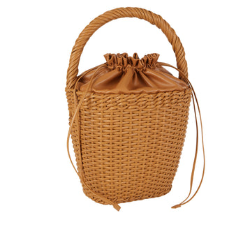 Edie Parker Lily Basket handbag woven straw caramel brown leather drawstring straw twisted handle