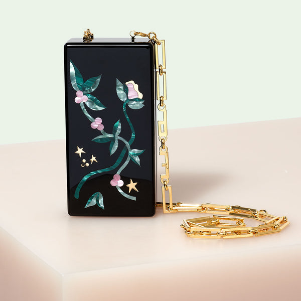 Edie Parker designer handbag clutch Minnie Currant and Stars in black with multi colored floral and star inlays and light gold chain.