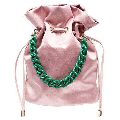 Edie Parker designer Shorty handbag in pale pink satin with drawstring closure and green top handle chain.