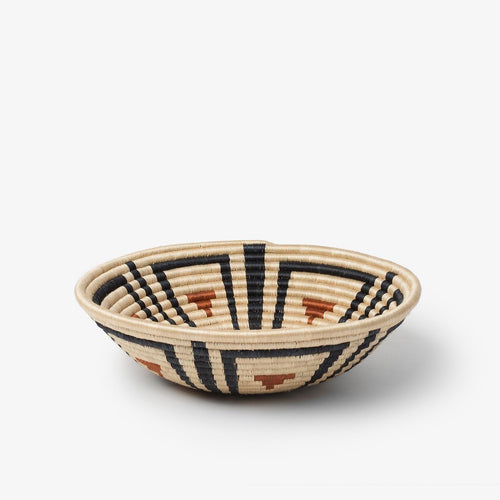 Akazi Burnt Orange hand woven basket by artisans from Rwanda. Free trade and ethically made.