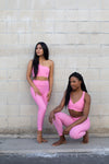 Two models wearing Aura 7 Activewear Flower Vita Legging yoga pants posing in front of brick wall on the street