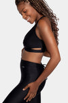 Aura7 Activewear crisscross malibu sports bra side profile with yoga pants
