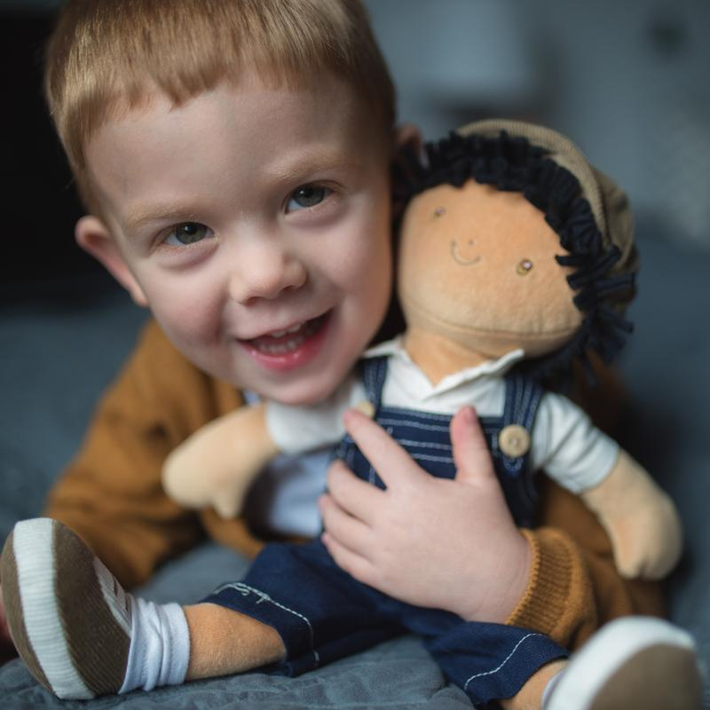 Young boy with a Bonikka Rag Doll