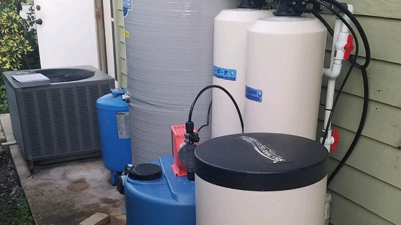 water softening system installed outside