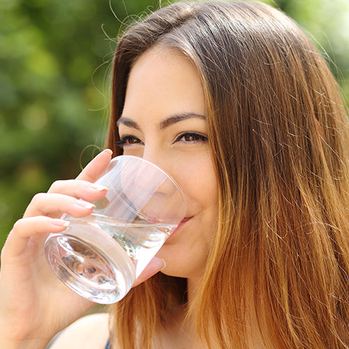 woman drinking a glass of water, water treatment products