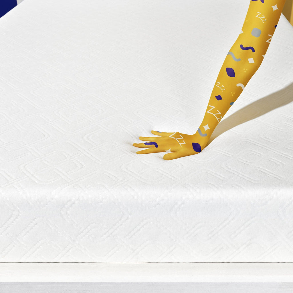 Foam - hand pressing on mattress